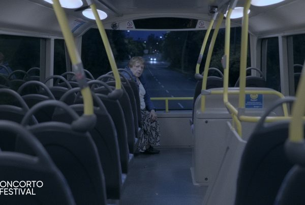 Who's that at the back of the bus?